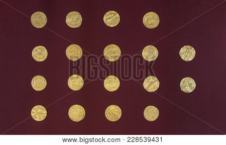Jaen, Spain - December 29th, 2017: Golden Almoravid Dinars With Carved Arabic Scripts, Jaen Archeolo