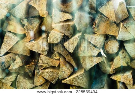 Preparation Of Firewood For The Winter. Firewood Background, Stacks Of Firewood In The Forest. Pile