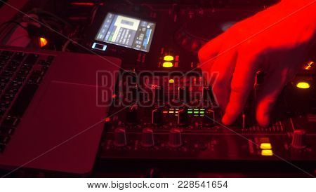 Ibiza, Spain - February 02, 2018: Dj Playing Music Mixing Sounds, Hand Close-up.