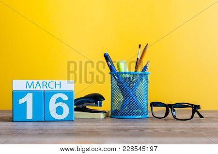 March 16th. Day 16 Of March Month, Calendar On Table With Yellow Background And Office Or School Sup