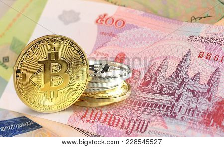 Bitcoin Coins On Cambodian Riel Banknote, Cryptocurrency Concept Photo