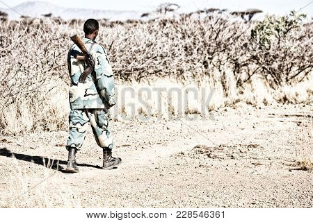 A Black Soldier And His Gun Looking The Boarder