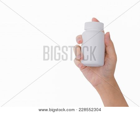 Woman's Hand Holding Prescription Pills Bottle With Blank Label Isolated On White Background With Co