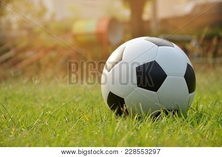 Football Or Soccer Ball On The Lawn With Morning Sunlight,outdoor Activities.