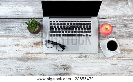 Office Desktop Setting With Laptop Plus Food And Drink On White Rustic Desk