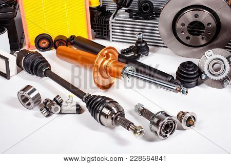 Assortment Of New Parts For Vehicle Repair Isolated On White.