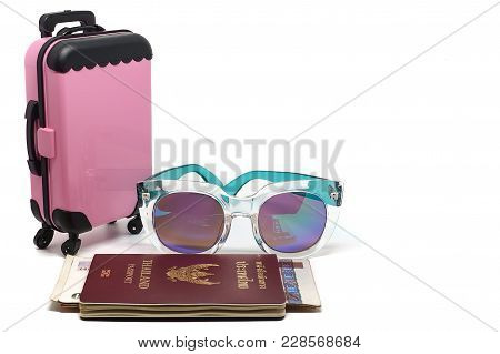 Pink Luggage, Thai Passport With Banknotes And Fashion Sunglasses On White Background For Traveling