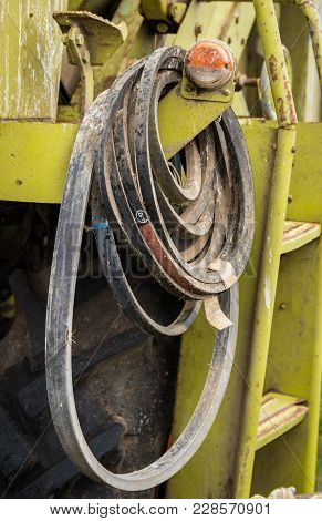 Some Spare Machine Drive Bels Hanging On A Harvester.