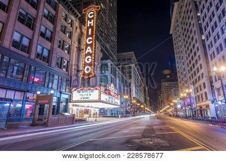 Chicago, Il - February 18, 2018: Famous Chicago Theatre Neon Sign And Night Street Scene.