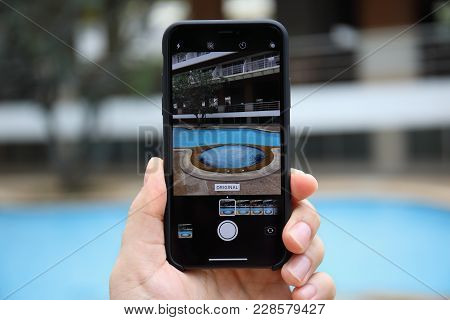 Koh Samui, Thailand - January 22, 2018: Man Hand Holding Iphone X With Photo Camera On The Screen. I