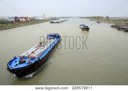 Yangzhou City, China - Apr 30, 2009: Cargo Ships Navigating In The Grand Canal (known To The Chinese