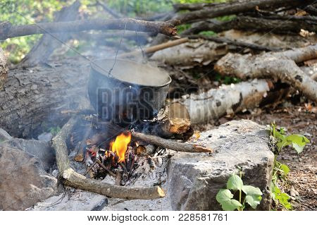 Boiling Pot Above The Fire, Tourist Meal Cooking On Fire, Hot Tea On Fire
