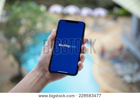 Koh Samui, Thailand - January 31, 2018: Woman Hand Holding Iphone X With Application Booking.com Onl
