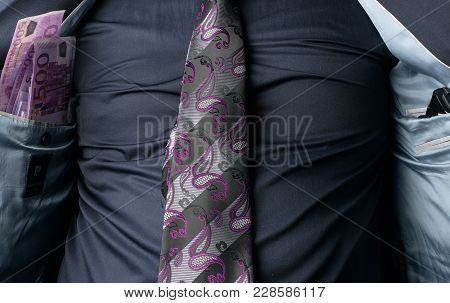Businessman Showing Euro Money And Pistol In Inner Pocket Of His Suit. Concept Of Corrupted Business