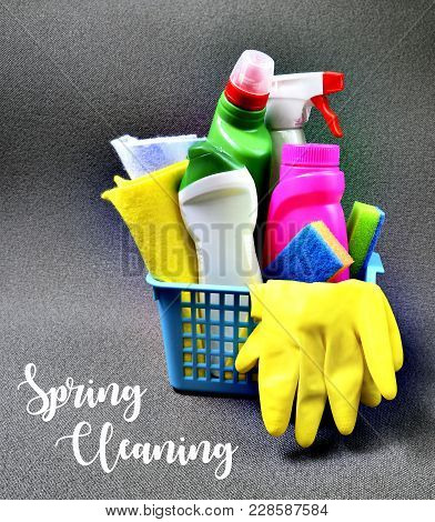 Spring Cleaning Concept.colorful Set Of Cleaning Supplies In A Blue Basket With Text.selective Focus