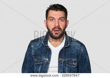 Stupefied Bearded Man Looks With Astonishment Into Camera