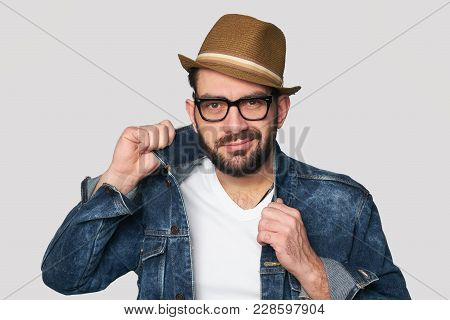 Bearded Hipster In Cap, Denim Jacket And Spectacles