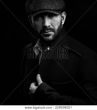 Bearded Man Wearing Peaked Cap
