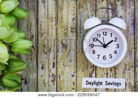 Daylight Savings Time Spring Concept Top Down View With White Clock And Green Tulips