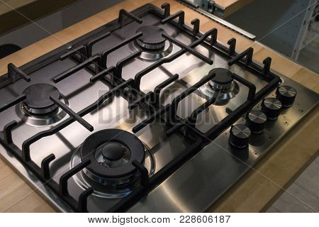 Gas Cooker Close-up. Kitchen Necessity. Four Burners. Food.