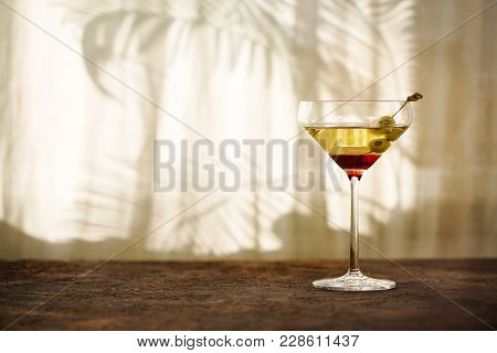 Glasses With Martini And Green Olives, Focus On Olives