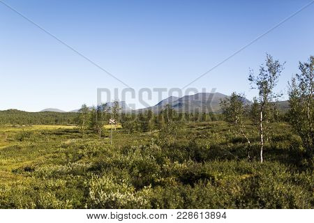 Lapporten, A Mountain Pass In Lapland, Sweden Viewed From Far Away. A Cross Marks Out The Walking Tr