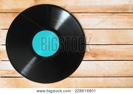 Record Vinyl Plate On Wooden Background, Copy Space