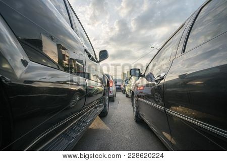 Cars On City Street In Traffic Jam At Rush Hour