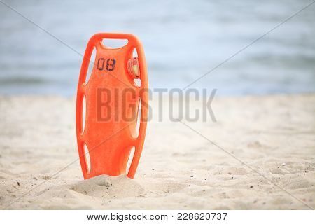 Beach Life-saving. Lifeguard Rescue Equipment Orange Preserver Tool, Red Plastic Buoyancy Aid In The