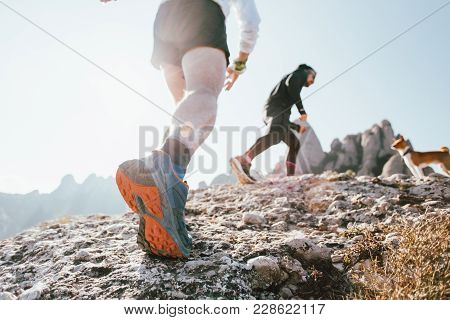 Two Friends Or Workout Buddies Together With Pet Dog On Hiking Or Trekking Trip Explore Mountain Tra