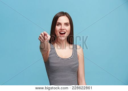 I choose you and order. The smiling woman point you, want you, half length closeup portrait on blue studio background. The human emotions, facial expression concept. Front view. Trendy colors poster