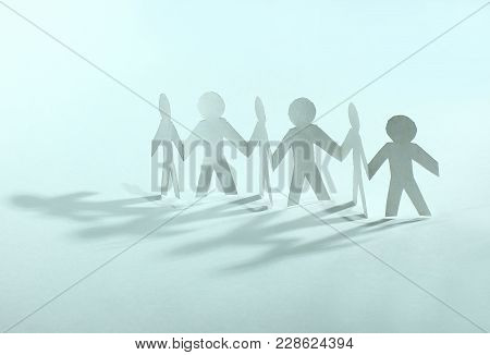 Concept Of Teamwork.team Paper Men Standing .photo With Copy Space.
