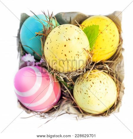 Decoration Easter Eggs With Copy Space.  Easter Eggs In Egg Cartoon Box On White Rustic Wooden Backg