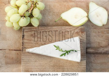 Cheese Plate Soft Brie Cheese, Grapes And  Pears On White Table. Top View. Copy Space. Camembert Che