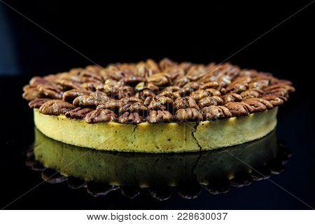 Brown Almond Coated Tart On Black Background