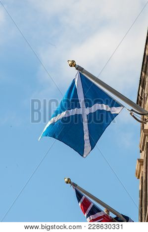 British Union Jack And Scottish Saltire On A Top Of City Chambers In Edinburgh, Scotland