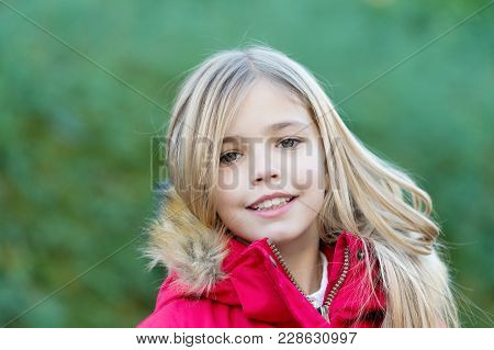 Girl With Blond Long Hair Smile On Natural Environment. Beauty, Nature, Growth. Happy Childhood Conc