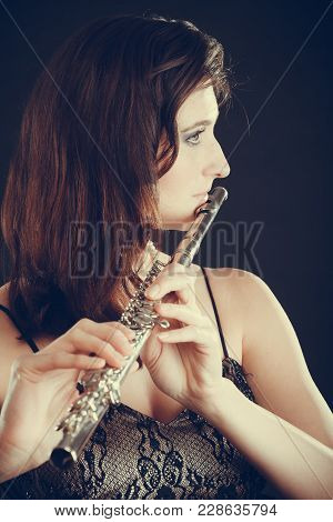 Music And Elegance. Alluring Elegant Woman Playing On Transverse Flute. Female Musician With Her Ins