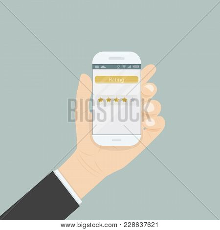 Hand Holding Smartphone With Rating Or Raking Concept On The Screen.5 Stars Rating Or Raking Concept