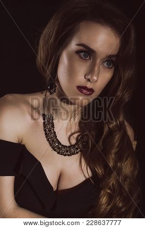 Portrait Of An Attractive, Elegant, Mysterious Young Woman In A Retro Image. Studio Photo. Fashion P