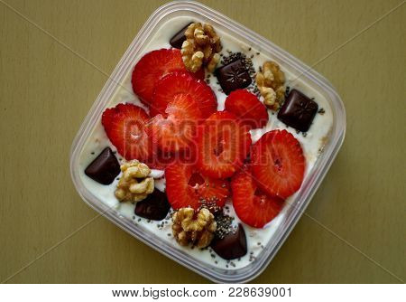 Porridge With Chia Seeds, Strawberries, Walnuts And Chocolate.oatmeal, Strawberries, Chocolate, Whit