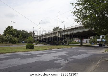Crossroad In The City. Road And Viaduct Situated Under The Dark Sky.