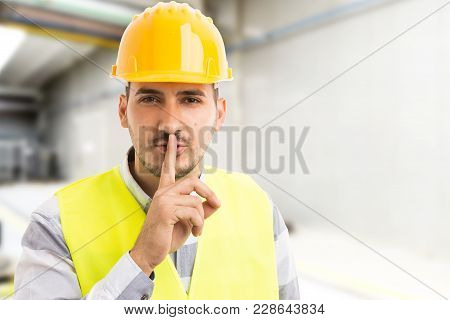 Factory Or Company Engineer Making Shush Silence Gesture.