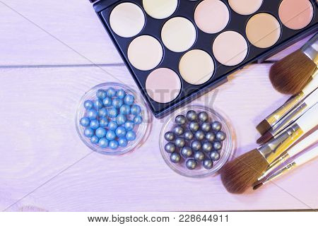 A Palette Of Concealer And Foundation, Grey And Blue Pearl Eyeshadow In Balls And A Set Of Brushes O