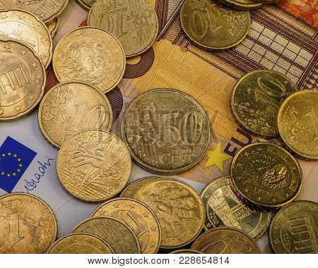 Coins Euro Cents Are On A Paper Bill Of Fifty Euros.  Euro Money.  Currency Of The European Union.
