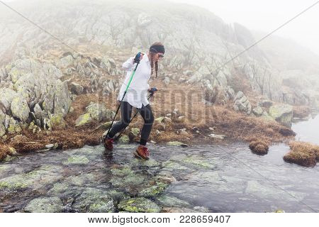 Young Traveler Woman Walks Through The River.