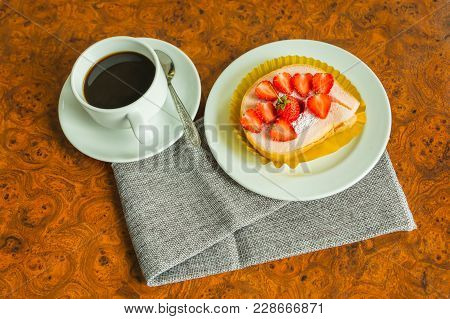 Cake With Cream And Strawberries On A Dark Wood Background. Tinting. Selective Focus