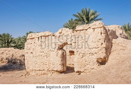 Ruins of an old settlement in an oasis in Al Ain, in the emirate of Abu Dhabi, United Arab Emirates. poster