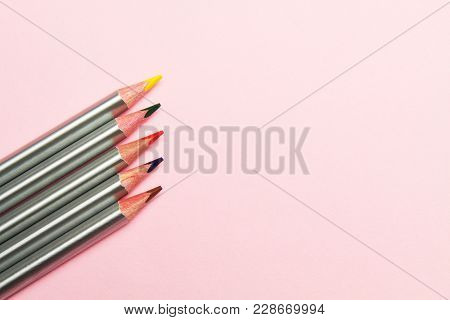 Colored Pencils On Pastel Pink Background. Trend Colors, Pattern.multi-colored Wooden Pencils With S