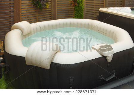 White Octagon Bathtub. Whirlpool And Bubble In Bathtub.